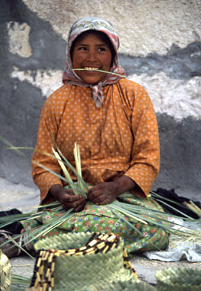 In Mexico's Copper Canyon, a Tarahumara lady weaves a basket.